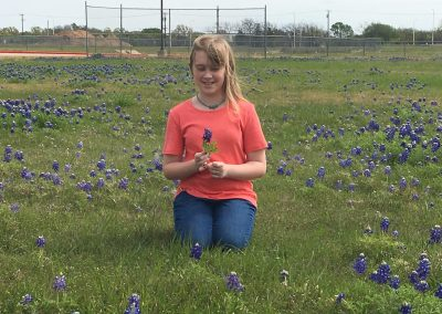 Sitting in the bluebonnets
